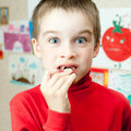 Boy holding missing teeth Stock Photography