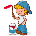 Boy holding a paint roller and bucket
