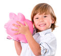 Boy holding a piggybank happy isolated over white background Stock Photography