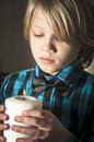Boy holding a religious candle young lookat and christmas Royalty Free Stock Image