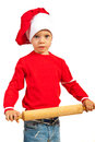 Boy holding rolling pin chef toddler in red isolated on white background Stock Photo
