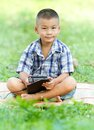 Boy holding tablet pc in garden Royalty Free Stock Photos
