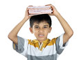 Boy holding the textbook with expression indian school Royalty Free Stock Image