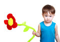 Boy holding toy flower little two and half years old Royalty Free Stock Photos