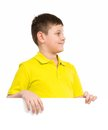 Boy holding a white placard place for text Stock Photo