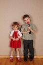 Boy holds red heart for girl Royalty Free Stock Images