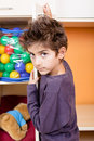 Boy hooked toys closet door Royalty Free Stock Photo