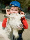 Boy hugging a goat Stock Images
