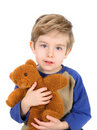 Boy hugging his bear Royalty Free Stock Images