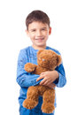 Boy hugging a teddy bear Royalty Free Stock Photo