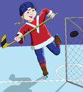 Boy ice hockey player scored a goal against Stock Image