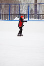 Boy on the ice rink skating outdoors photo with space for copy Stock Images