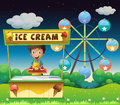 A boy with an icecream stall near the ferris wheel illustration of Stock Photography