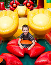 Boy in inflatable playground Royalty Free Stock Images
