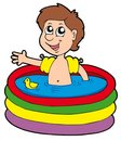 Boy in inflatable pool Stock Photography