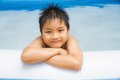 Boy and inflatable pool play swim in plastic Royalty Free Stock Photos