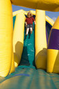 Boy on Inflatable Slide Royalty Free Stock Photo