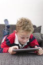 Boy on ipad a playing an Royalty Free Stock Photography