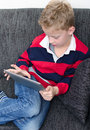 Boy on ipad a playing an Royalty Free Stock Photos