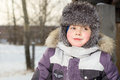 Boy in jacket walking in winter, ice skating, Royalty Free Stock Photo