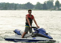 Boy on jetski teen personal watercraft a lake Stock Photos