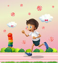 A boy jogging at the candyland illustration of Stock Photos