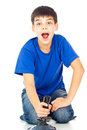 Boy with a joystick playing video games Stock Photography