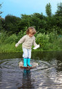 Boy jump in puddle happy Royalty Free Stock Photography