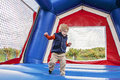 Boy jumping in bounce house toddler inside a Royalty Free Stock Photo