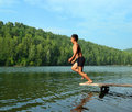 Boy jumping in lake Royalty Free Stock Images
