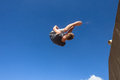 Boy Jumping Somersault Blue Parkour Royalty Free Stock Photo