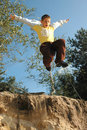 Boy jumps above the chasm Royalty Free Stock Image