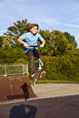 Boy jumps with scooter at the skate park Royalty Free Stock Images