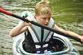 Boy in Kayak/Concentration Royalty Free Stock Photo