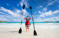 Boy with kayak paddles little holding at beach Royalty Free Stock Image
