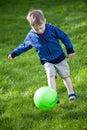Boy kicking ball Royalty Free Stock Images