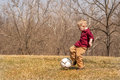 Boy kicking ball outside young a outdoors Stock Images