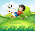 A boy kicking the soccer ball at the hilltop illustration of Royalty Free Stock Image