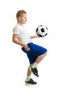 Boy kicking soccer ball by knee isolated on white training exercise Stock Images