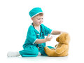 Boy kid playing doctor with toy Royalty Free Stock Image
