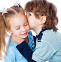 A boy is kissing a little girl Royalty Free Stock Image