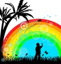 Boy with kite under rainbow Stock Images