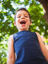 Boy laughing in park funny outdoors Stock Photography