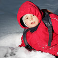 Boy laying in snow Stock Photography