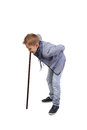 Boy leans on a stick Royalty Free Stock Photo