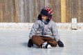 Boy learning to ice skate Royalty Free Stock Photos