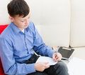 The boy is left-handed writing in a notebook Royalty Free Stock Photo