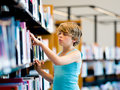 Boy in library choosing books Stock Photography