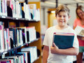 Boy in library Royalty Free Stock Photo