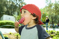 Boy licking a popsicle Royalty Free Stock Photo